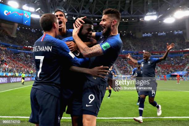 Samuel Umtiti of France is mobbed by his team after scoring his sides first goal during the 2018 FIFA World Cup Russia Semi Final match between...