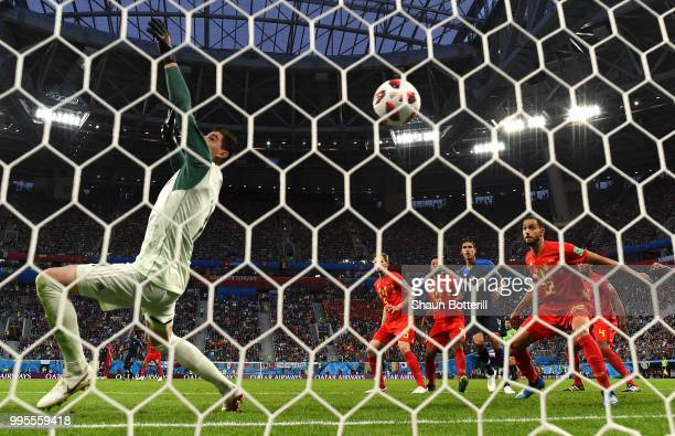 Samuel Umtiti of France scores his team's first goal past Thibaut Courtois of Belgium during the 2018 FIFA World Cup Russia Semi Final match between...