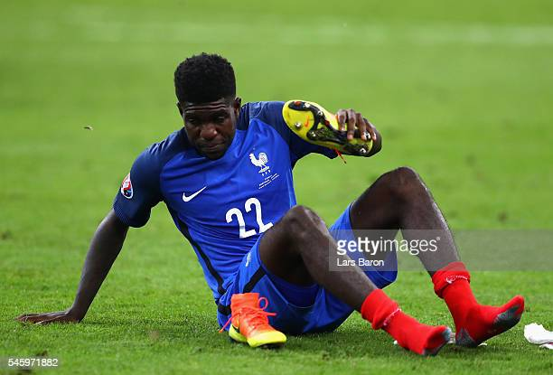 Samuel Umtiti of France shows his dejection after his team's 01 defeat in the UEFA EURO 2016 Final match between Portugal and France at Stade de...