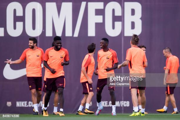 Samuel Umtiti Ousmane Dembele and Lucas Digne of FC Barcelona share a joke during a training session ahead of the UEFA Champions League Group D match...