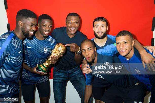 Samuel Umtiti Ousmane Dembele Marcel Desailly Kylian Mbappé Djibril Sidibé Nabil Fekir and Kylian Mbappé of France pose with the Champions World Cup...