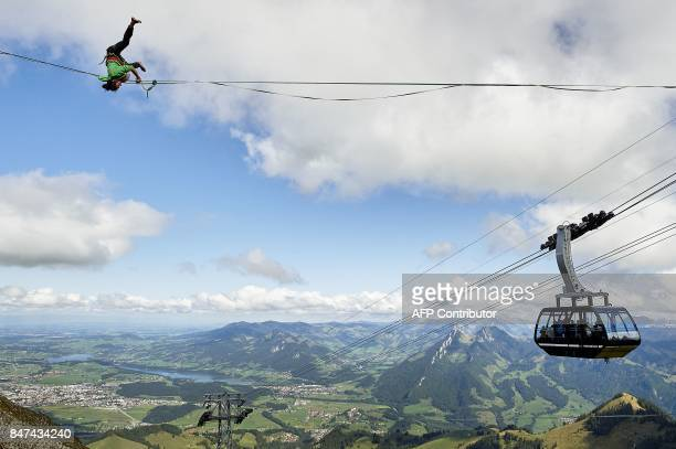 Samuel Volery of Switzerland performs on the line during the Highline Extreme event in Moleson peak western Switzerland on September 15 2017 Fifty of...
