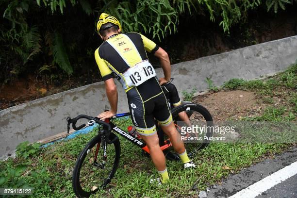 Samuel Volkers of Australia and CCN Cycling Team Laos tire is broken during stage 9 of the Tour de Singkarak 2017 PasamanBukittinggi 1172 km on...