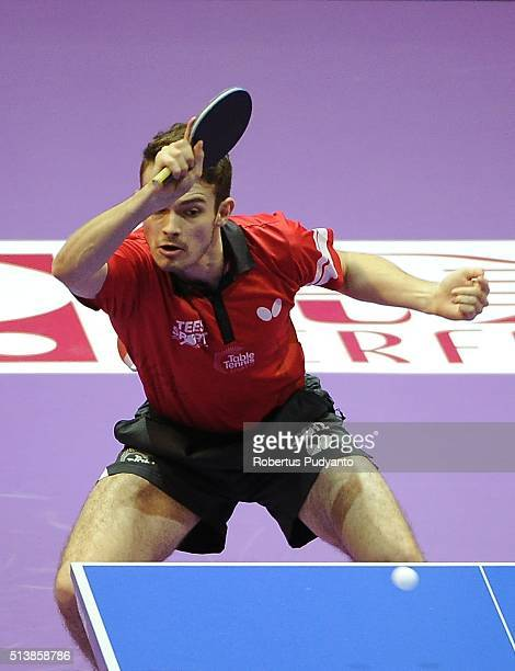 Samuel Walker of England competes against Yuya Oshima of Japan during the 2016 World Table Tennis Championship Men's Team Division semifinal match at...