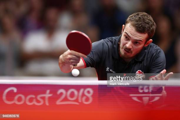 Samuel Walker of England plays a shot against Sharath Achanta of India in their Men's Singles Bronze Medal Match during Table Tennis on day 11 of the...