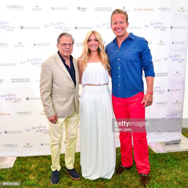 Samuel Waxman MD Ramy Brook Sharp and Chris Wragge attend The Samuel Waxman Cancer Research Foundation 14th Annual The Hamptons Happening on July 14...
