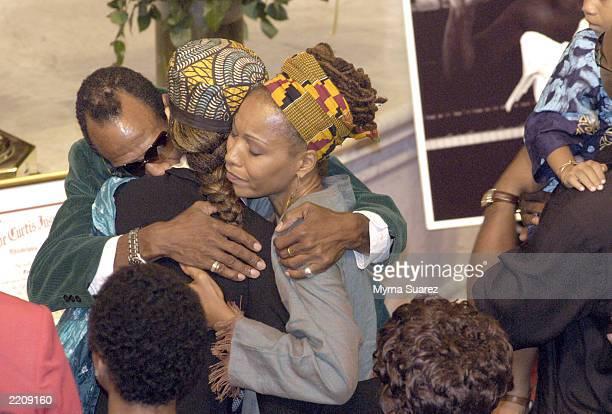 Samuel Waymon and Simone the son and daughter of late Jazz singer Nina Simone hug Attallah Shabaaz daugher of Malcom X and Betty Shabaaz as they...