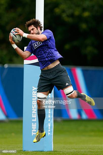 Samuel Whitelock of the All Blacks collects a high ball during a New Zealand All Blacks training session at Lensbury on September 16, 2015 in London,...