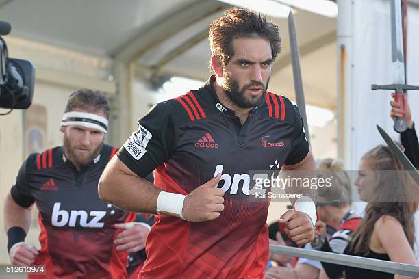 Samuel Whitelock of the Crusaders leads his team onto the field followed by Kieran Read prior to the round one Super Rugby match between the...