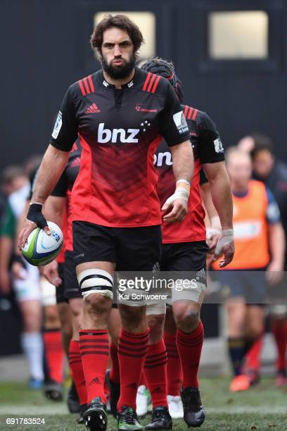 Samuel Whitelock of the Crusaders leads his team onto the field during the round 15 Super Rugby match between the Crusaders and the Highlanders at...