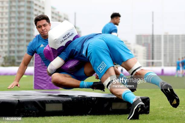Samuel Whitelock tackles Anton LienertBrown of the All Blacks during a New Zealand training session at the Arcs Urayasu Park on October 11 2019 in...