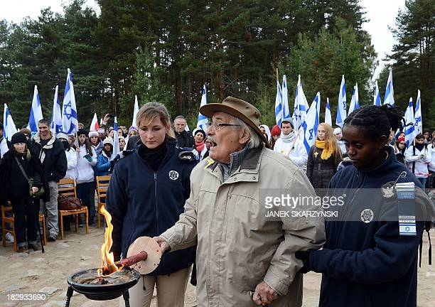 Samuel Willenberg the only living survivor of an August 1943 prisoner rebellion at Treblinka lights a candle in front of the monument of Treblinka...
