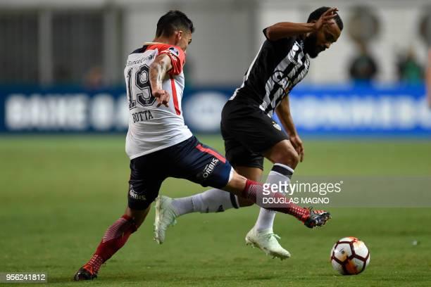 Samuel Xavier of Brazil's Atletico Mineiro is challenged by Ruben Botta of Argentina's San Lorenzo, during their Copa Sudamericana football...