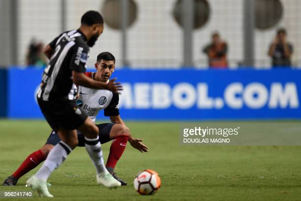 Samuel Xavier of Brazil's Atletico Mineiro, vies for the ball with Franco David Moyano of Argentina's San Lorenzo, during their 2018 Copa...