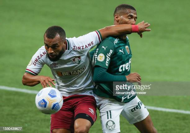 Samuel Xavier of Fluminense and Wesley of Palmeiras fight for the ball during a match between Palmeiras and Fluminense as part of Brasileirao 2021 at...