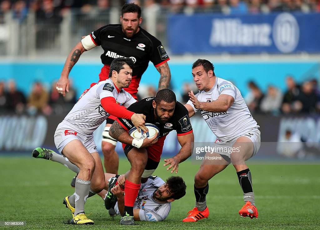 Samuela Vunisa of Saracens is tackled during the European Rugby Champions Cup match between Saracens and Oyonnax at Allianz Park on December 19, 2015 in Barnet, England.