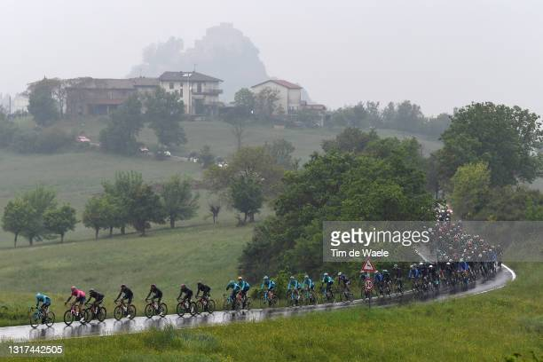 Samuele Battistella of Italy and Team Astana – Premier Tech, Filippo Ganna of Italy and Team INEOS Grenadiers Pink Leader Jersey lead The Peloton...