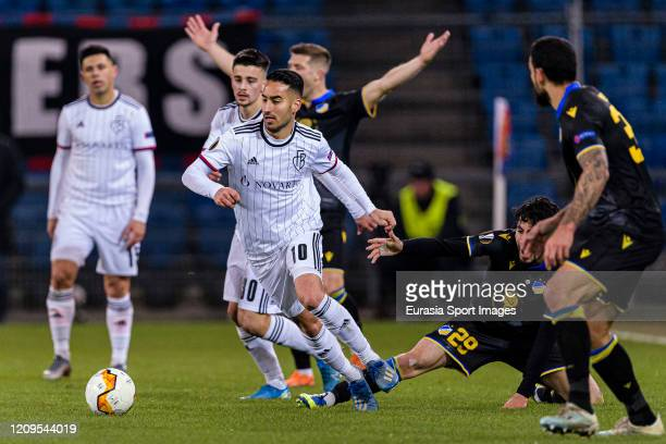 Samuele Campo of Basel dribbles Praxitelis Vouros of Apoel during the UEFA Europa League round of 32 second leg match between FC Basel and APOEL...