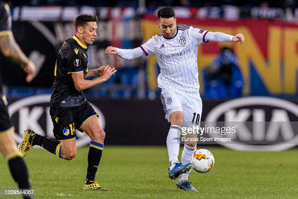 Samuele Campo of Basel in action against Uros Matic of Apoel during the UEFA Europa League round of 32 second leg match between FC Basel and APOEL...