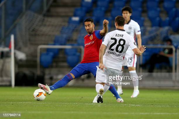 Samuele Campo of FC Basel 1893 and Dominik Kohr of Eintracht Frankfurt battle for the ball during the UEFA Europa League round of 16 second leg match...