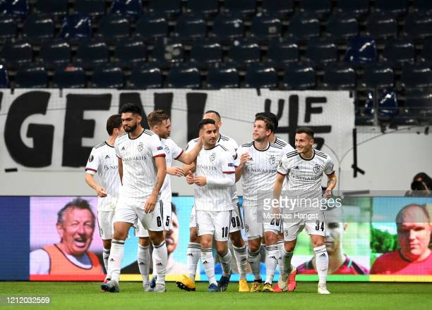 Samuele Campo of FC Basel celebrates with his team mates after scoring his team's first goal during the UEFA Europa League round of 16 first leg...