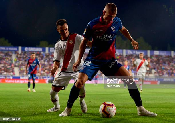 Samuele Longo Alvaro Garcia battle for the ball during the match between SD Huesca against Rayo Vallecano at Alcoraz Stadium in Huesca Spain on...