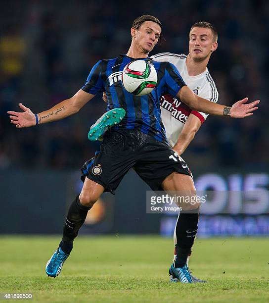 Samuele Longo of FC Internazionale Milano competes for the ball with Alex Rodrigo Dias Da Costa of AC Milan during the AC Milan vs FC Internacionale...