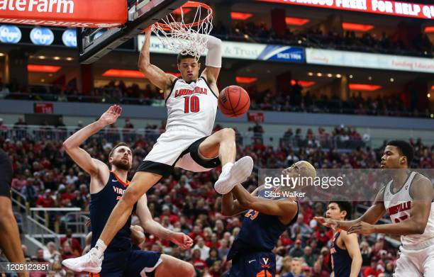 Samuell Williamson of the Louisville Cardinals dunks the ball against the Virginia Cavaliers during the first half of the game at KFC YUM Center on...