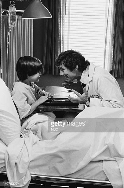 ST ELSEWHERE Samuels and the Kid Episode 5 Pictured Jeremy Licht as Robbie Durant David Birney as Dr Ben Samuels Photo by Gary Null/NBCU Photo Bank