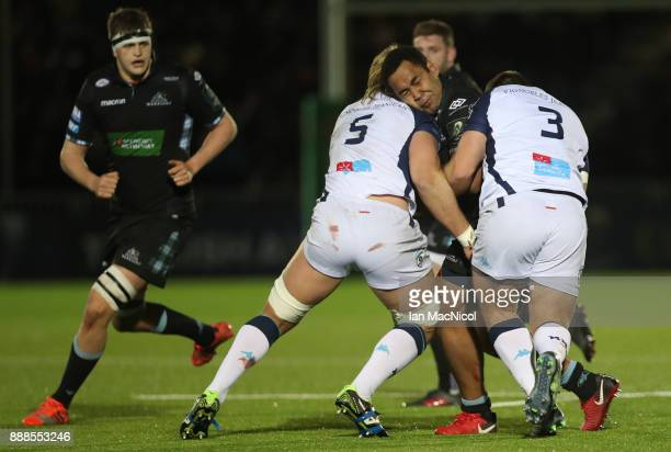 Samula Vunisa of Glasgow Warriors is tackled by Jacques Du Plessis of Montpellier during the European Rugby Champions Cup match between Glasgow...