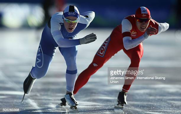 Samuli Suomalainen of Finland and Gawel Oficjalski of Poland compete in the men 1500 m heats during day 1 of ISU speed skating junior world cup at...