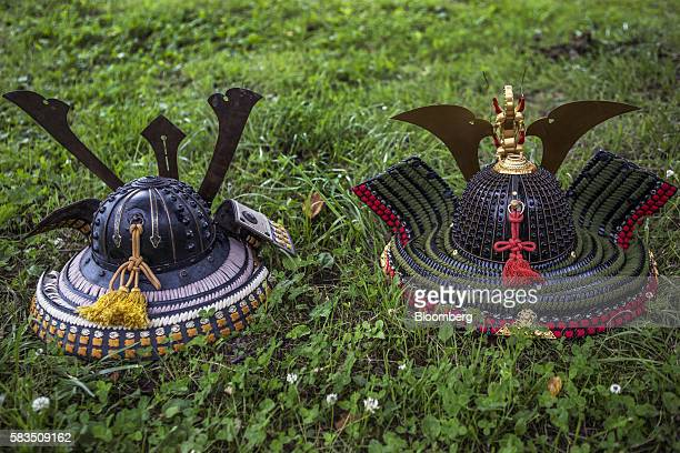 Samurai helmets known as Kabuto sit on the ground during the Soma Nomaoi festival in Soma Fukushima Prefecture Japan on Saturday July 23 2016 Every...