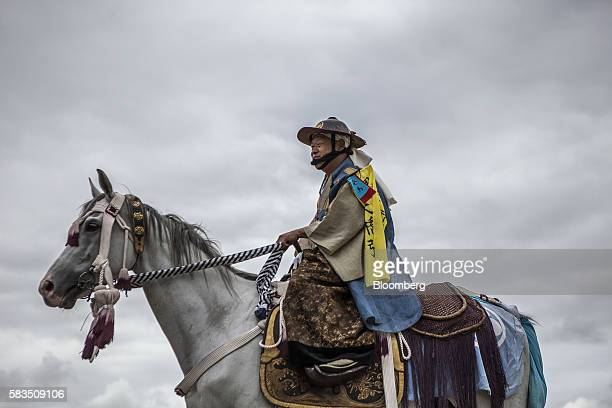 Samurai horseman makes his way through Hibarigahara field during the Soma Nomaoi festival in Minamisoma, Fukushima Prefecture, Japan, on Saturday,...