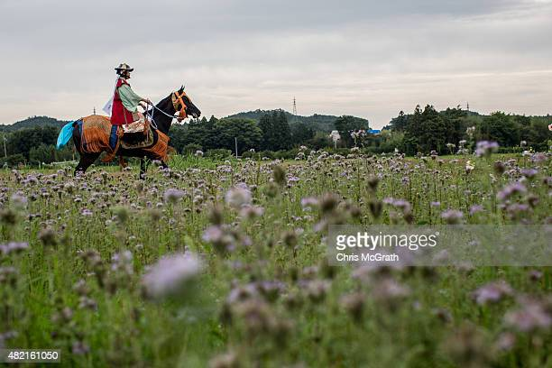 Samurai horseman rides his horse on a road to the Ohta Shrine for the morning ritual ahead of the the Soma Nomaoi festival on July 25 2015 in...