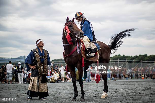 Samurai horseman wait for a parade to start after the morning ritual at Ohta Shrine ahead of the the Soma Nomaoi festival on July 25, 2015 in...