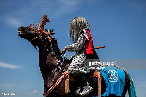 A samurai horseman waits to take part in the Kacchukeiba during the Soma Nomaoi festival at Hibarigahara field on July 26 2015 in Minamisoma Japan...