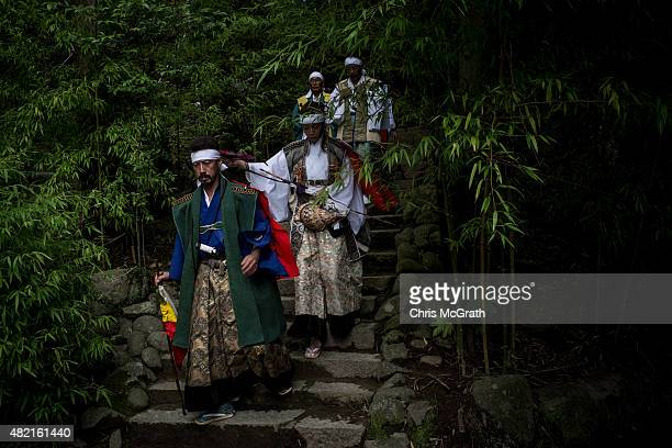 A samurai horseman walks down from the nakamura Shrine after taking part in a ritual ahead of the Soma Nomaoi festival on July 24 2015 in Minamisoma...