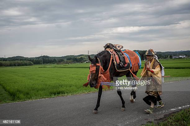 Samurai horseman walks his horse to the Ohta Shrine for the morning ritual ahead of the the Soma Nomaoi festival on July 25 2015 in Minamisoma Japan...
