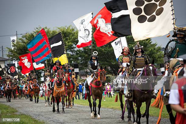 "Samurai horsemen is seen parade during the ""Hon Matsuri"", Soma Nomaoi festival at Hibarigahara field on Sunday, July 24, 2016 in..."