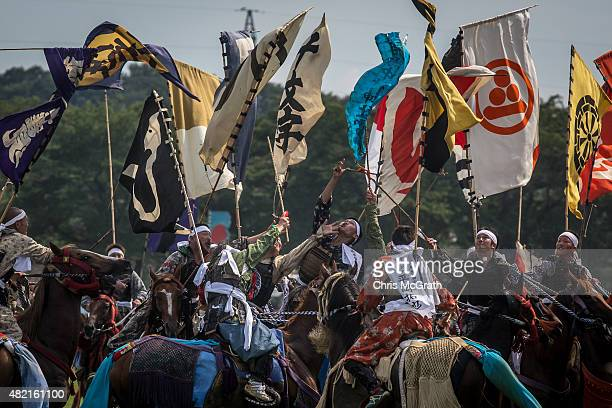 Samurai horsemen jostle for position as they try to catch a flag during the Shinkisoudatsusen at the Soma Nomaoi festival at Hibarigahara field on...