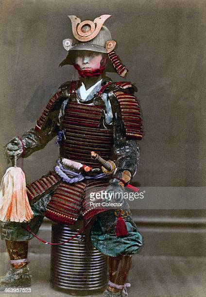 A samurai in armour Japan 1882 A photograph from Labor and Porcelain in Japan by the United States ConsulGeneral Yokohama 1882