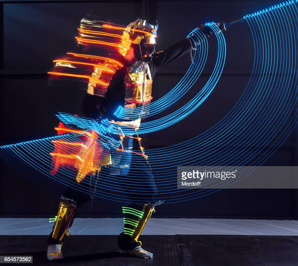 Samurai In LED Costume Is Showing Dance Of Light