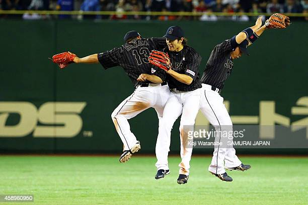 Samurai Japan members celebrate after winning the game two of Samurai Japan and MLB All Stars at Tokyo Dome on November 14 2014 in Tokyo Japan