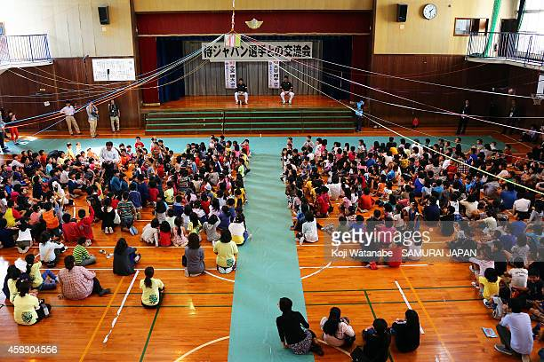 Samurai Japan players visit a Naha school prior to the exhibition game between Samurai Japan and MLB All Stars at Okinawa Cellular Stadium on...