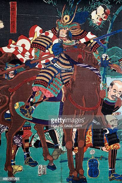 A samurai on horseback preparing to go into battle sewamono 19th century ukiyoe art print from the Kabuki theatre series woodcut Japanese...