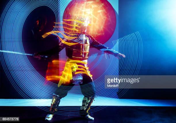 Samurai Performing Dance Leaving LED Glowing Trace