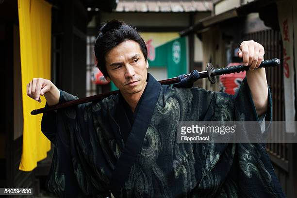 Samurai Posing In Traditional Japanese Village