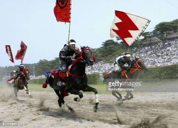 Samurai Riders dressed in full medieval armour take part in an equestrian contest during the Soma-Nomaoi festival on July 24, 2004 in Haramachi City,...