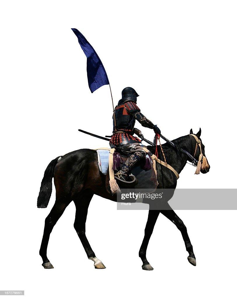 Samurai riding a horse : Stock Photo