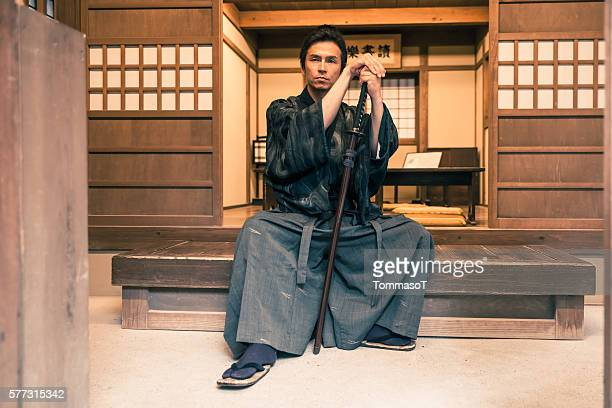 Samurai sitting with his katana